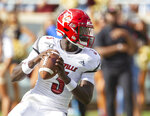 Louisville quarterback Malik Cunningham (3) drops back to pass against Florida State in the first half of an NCAA college football game in Tallahassee, Fla., Saturday, Sept. 21, 2019. Florida State defeated Louisville 35-24.  (AP Photo/Mark Wallheiser)