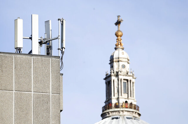 Mobile network phone masts are visible in front of St Paul's Cathedral in the City of London, Tuesday, Jan. 28, 2020. The Chinese tech firm Huawei has been designated a