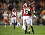 Alabama's Tua Tagovailoa and Josh Jacobs (8) celebrate after a touchdown pass during the first half the NCAA college football playoff championship game against Clemson, Monday, Jan. 7, 2019, in Santa Clara, Calif. (AP Photo/Ben Margot)