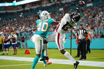 Atlanta Falcons wide receiver Christian Blake (13) can't hold onto a pass in the endzone as Miami Dolphins defensive back Nik Needham (40) defends, during the first half of a preseason NFL football game, Saturday, Aug. 21, 2021, in Miami Gardens, Fla. (AP Photo/Lynne Sladky)