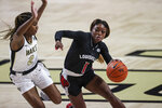 Louisville guard Dana Evans (1) drives around Wake Forest guard Kaia Harrison (2) in the first quarter of an NCAA women's college basketball game in Winston-Salem, N.C., Sunday, Jan. 24, 2021. (AP Photo/Nell Redmond)