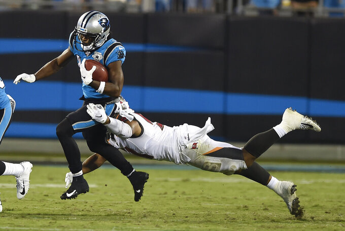 Tampa Bay Buccaneers linebacker Kevin Minter (51) dives to tackle Carolina Panthers wide receiver Ray-Ray McCloud (14) during the first half of an NFL football game in Charlotte, N.C., Thursday, Sept. 12, 2019. (AP Photo/Mike McCarn)
