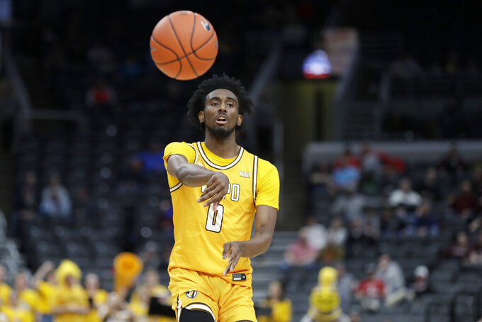 Valparaiso's Javon Freeman-Liberty passes during the first half of an NCAA college basketball game against Missouri State in the semifinal round of the Missouri Valley Conference men's tournament Saturday, March 7, 2020, in St. Louis. (AP Photo/Jeff Roberson)