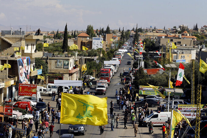 A convoy of tanker trucks carrying Iranian diesel crossed the border from Syria into Lebanon, arrives at the eastern town of el-Ain, Lebanon, Thursday, Sept. 16, 2021. The delivery, organized by the Iranian-backed Hezbollah group, violates U.S. sanctions imposed on Tehran after former President Donald Trump pulled America out of a nuclear deal between Iran and world powers three years ago. (AP Photo/Bilal Hussein)