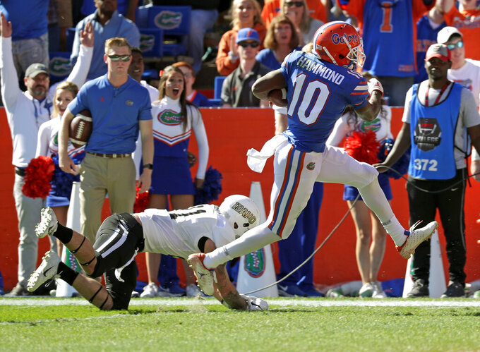 "FILE - In this Nov. 17, 2018, file photo, Florida wide receiver Josh Hammond (10) runs past Idaho defensive back Jordan Grabski for a touchdown during the first half of an NCAA college football game in Gainesville, Fla. Hammond was ""a little shocked"" he didn't get an invite to the NFL combine. He was equally surprised he didn't get asked to the Senior Bowl. Those collegians who never got a full look _ or even a slight glance _ from NFL teams because of the coronavirus pandemic could wind up sinking in the draft, or falling out of it completely. (AP Photo/John Raoux, File)"