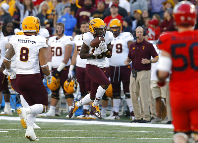Arizona State safety Aashari Crosswell (16) intercepts the football against Arizona in the second half during an NCAA college football game, Saturday, Nov. 24, 2018, in Tucson, Ariz. (AP Photo/Rick Scuteri)