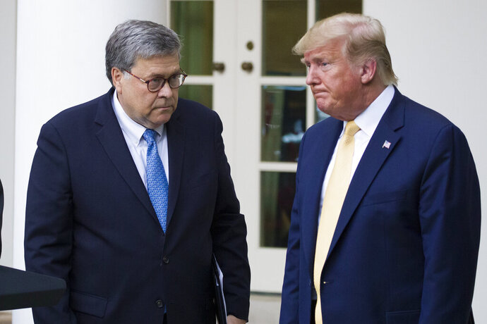 "FILE - In this July 11, 2019, file photo, Attorney General William Barr, left, and President Donald Trump turn to leave after speaking in the Rose Garden of the White House, in Washington. Attorney General William Barr took a public swipe Thursday at President Donald Trump, saying that the president's tweets about Justice Department prosecutors and cases ""make it impossible for me to do my job.""  Barr made the comment during an interview with ABC News just days after the Justice Department overruled its own prosecutors. they had initially recommended in a court filing that President Donald Trump's longtime ally and confidant Roger Stone be sentenced to 7 to 9 years in prison. But the next day, the Justice Department took the extraordinary step of lowering the amount of prison time it would seek for Stone. (AP Photo/Alex Brandon, File)"