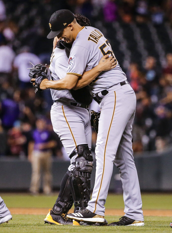 Pittsburgh Pirates starting pitcher Jameson Taillon hugs catcher Francisco Cervelli after the team's baseball game against the Colorado Rockies, Tuesday, Aug. 7, 2018, in Denver. Taillon threw a complete game and the Pirates defeated the Rockies 10-2. (AP Photo/Jack Dempsey)