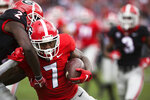 FILE - In this April 20, 2019, file photo, Georgia running back D'Andre Swift (7) runs the ball in the first half of an NCAA college football spring game in Athens, Ga. Georgia  fully expects to contend for a national championship. Now, the Bulldogs have to show they can finish the job after coming tantalizingly close the last two seasons. (Jenn Finch/Athens Banner-Herald via AP, File)