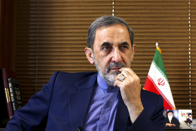 FILE - In this Aug. 18, 2013, file photo, Ali Akbar Velayati, a top adviser to Iran's supreme leader Ayatollah Ali Khamenei, gives an interview to The Associated Press at his office in Tehran, Iran. Velayathi said in a video online Saturday, July 6, 2019, that the Islamic Republic is ready to begin enriching uranium beyond the level set by Tehran's 2015 nuclear deal with world powers. (AP Photo/Ebrahim Noroozi, File)