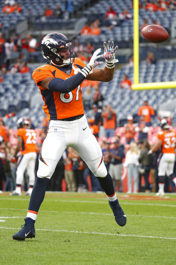 Denver Broncos tight end Noah Fant (87) catches a pass during warm-ups prior to an NFL game against the Kansas City Chiefs, Thursday, Oct. 17, 2019, in Denver. The Chiefs defeated the Broncos 30-6. (Margaret Bowles via AP)