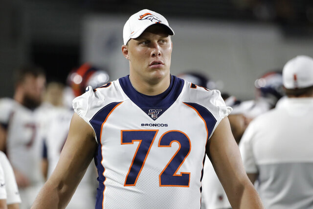 In this Aug. 24, 2019 file photo Denver Broncos offensive tackle Garett Bolles (72) stands near the field during an NFL preseason football game against the Los Angeles Rams in Los Angeles. A person with knowledge of the decision tells The Associated Press that the Broncos have declined the fifth-year contract option on left tackle Garett Bolles, Friday, May 1, 2020. (AP Photo/Rick Scuteri, file)