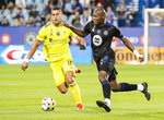 CF Montreal's Kamal Miller (3) challenges Nashville SC's Daniel Rios during the first half of an MLS soccer match Saturday, Sept. 11, 2021, in Montreal. (Graham Hughes/The Canadian Press via AP)