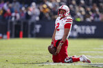 FILE - In this Saturday, Nov. 2, 2019 file photo, Nebraska quarterback Adrian Martinez (2) falls to his knees after failing to pick up a first down against Purdue during the second half of an NCAA college football game in West Lafayette, Ind. Adrian Martinez will be a rare four-year starting quarterback at Nebraska this fall and yet, for all his experience, he's one of the team's biggest mysteries. (AP Photo/Michael Conroy, File)