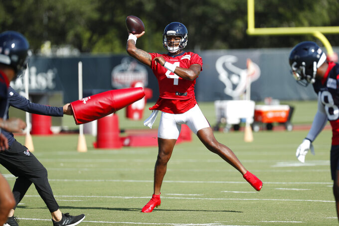 Houston Texans quarterback Deshaun Watson (4) throws a pass during an NFL training camp football practice Tuesday, Aug. 25, 2020, in Houston.  (Brett Coomer/Houston Chronicle via AP, Pool)