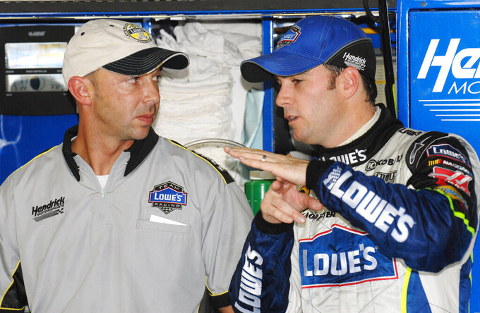 FILE - In this July 14, 2006, file photo, crew chief Chad Knaus, left, talks with driver Jimmie Johnson during practice for the Lenox Industrial Tools 300 at New Hampshire International Speedway in Loudon, N.H. Once Johnson was paired with Knaus as crew chief the duo took off and won a record-tying seven championships as the No. 48 team blossomed into one of the best in NASCAR history. But their relationship could be bumpy despite a 17-year friendship and all their success, and the strain of underperforming last year was the final push toward their split. (AP Photo/Sandy Macys, File)