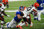 FILE - New York Giants' David Mayo (55) tackles Cleveland Browns' D'Ernest Johnson (30) during the second half of an NFL football game in East Rutherford, N.J., in this Sunday, Dec. 20, 2020, file photo. The New York Giants announced Thursday, March 4, 2021, that they have cut wide receiver and Golden Tate and linebacker David Mayo. (AP Photo/Corey Sipkin, File)