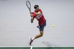 Serbia's Novak Djokovic returns the ball to Russia's Karen Khachanov during their Davis Cup tennis match in Madrid, Spain, Friday, Nov. 22, 2019. (AP Photo/Bernat Armangue)