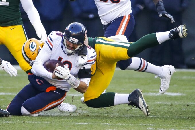 Green Bay Packers' Blake Martinez stops Chicago Bears' Mitchell Trubisky on a run during the first half of an NFL football game Sunday, Dec. 15, 2019, in Green Bay, Wis. (AP Photo/Mike Roemer)