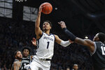 Butler forward Jordan Tucker (1) shoots over Providence forward Emmitt Holt (15) in the first half of an NCAA college basketball game in Indianapolis, Saturday, Feb. 1, 2020. (AP Photo/Michael Conroy)