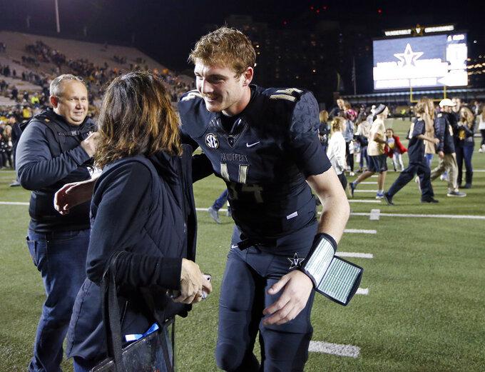 Vanderbilt quarterback Kyle Shurmur (14) is congratulated after his team defeated Tennessee in an NCAA college football game Saturday, Nov. 24, 2018, in Nashville, Tenn. (AP Photo/Mark Humphrey)