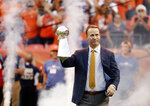 File-This Sept. 8, 2016, file photo shows, former Denver Broncos quarterback Peyton Manning carrying the Lombardi Trophy onto the field prior to an NFL football game between the Denver Broncos and the Carolina Panthers in Denver.  Manning was unanimously elected to the Broncos Ring of Fame on Wednesday, June 9, 2021.  He will be honored during the Broncos' game against Washington at Empower Field at Mile High on Halloween. His induction into the Pro Football Hall of Fame in Aug. 8. (AP Photo/Jack Dempsey, File)