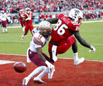 Florida State's Kyle Meyers (14) breaks up a pass intended for North Carolina State's Emeka Emezie (86) during the first half of an NCAA college football game in Raleigh, N.C., Saturday, Nov. 3, 2018. (AP Photo/Chris Seward)