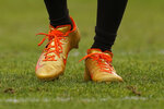 Cleveland Browns wide receiver Jarvis Landry wears a pair of custom cleats during the first half of NFL football game against the Denver Broncos, Sunday, Nov. 3, 2019, in Denver. The NFL made both Landry and Odell Beckham change their cleats at halftime. (AP Photo/Jack Dempsey)