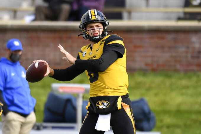 Missouri quarterback Connor Bazelak warms up before the start of an NCAA college football game against Kentucky Saturday, Oct. 24, 2020, in Columbia, Mo. (AP Photo/L.G. Patterson)