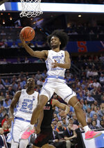 North Carolina's Coby White (2) drives to the basket against Louisville during the first half of an NCAA college basketball game in the Atlantic Coast Conference tournament in Charlotte, N.C., Thursday, March 14, 2019. (AP Photo/Chuck Burton)