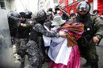 A backer of former President Evo Morales scuffles with police in La Paz, Bolivia, Nov. 13, 2019. (AP Photo/Natacha Pisarenko)