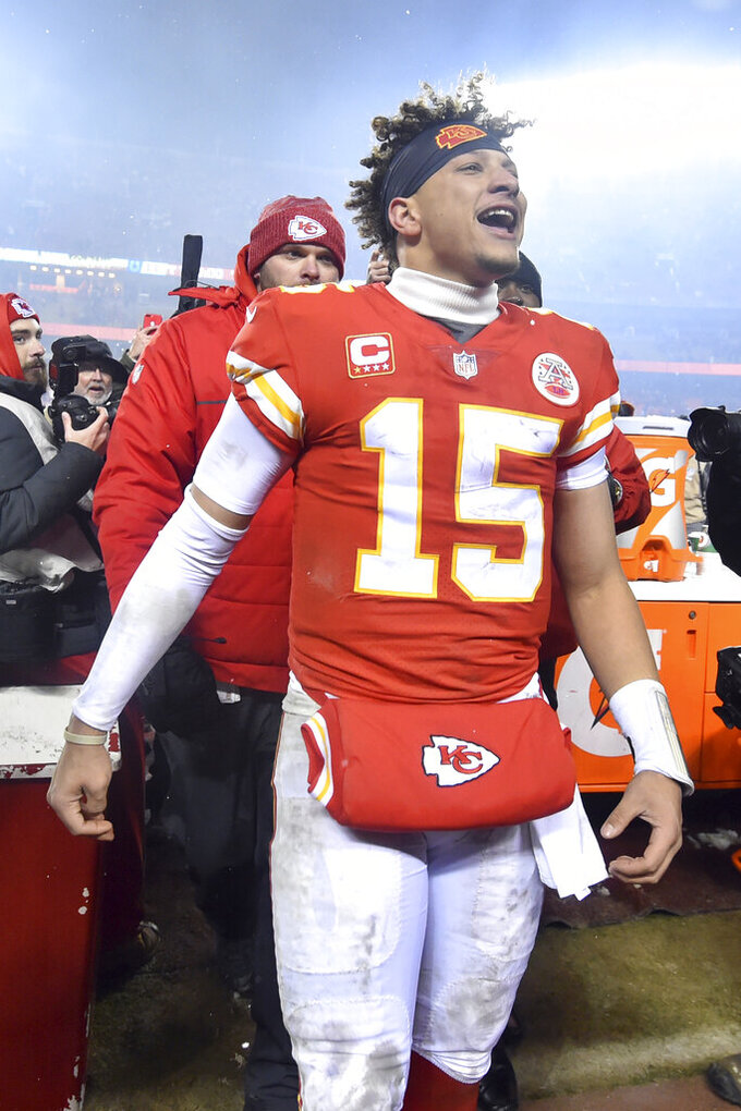 Kansas City Chiefs quarterback Patrick Mahomes (15) interacts with fans following the team's NFL divisional football playoff game against the Indianapolis Colts in Kansas City, Mo., Saturday, Jan. 12, 2019. The Chiefs won 31-13. (AP Photo/Ed Zurga)