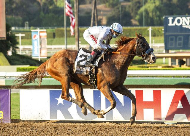 In a photo provided by Benoit Photo, Improbable and jockey Drayden Van Dyke win the Grade I, $300,000 Awesome Again Stakes horse race Saturday, Sept. 26, 2020, at Santa Anita in Arcadia, Calif. (Benoit Photo via AP)