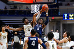 Connecticut's Isaiah Whaley (5) and Villanova's Brandon Slater (3) leap for a rebound during the second half of an NCAA college basketball game, Saturday, Feb. 20, 2021, in Villanova, Pa. (AP Photo/Matt Slocum)
