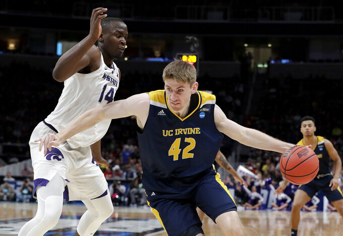 UC Irvine forward Tommy Rutherford (42) drives past Kansas State forward Makol Mawien (14) during the second half of a first round men's college basketball game in the NCAA Tournament Friday, March 22, 2019, in San Jose, Calif. (AP Photo/Chris Carlson)