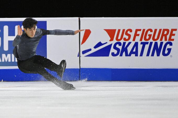 Nathan Chen falls during the men's short program at the Skate America figure skating event Friday, Oct. 22, 2021, in Las Vegas. (AP Photo/David Becker)