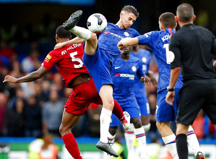 Chelsea's Jorginho goes for the ball during the British Premier League soccer match between Chelsea and Liverpool, at the Stamford Bridge Stadium, London, Sunday, Sept. 22, 2019. (AP Photo/Frank Augstein)