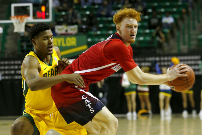 Baylor guard Jared Butler (12) defends as Arizona guard Nico Mannion (1) looks for space during the first half of an NCAA college basketball game in Waco, Texas, Saturday, Dec. 7, 2019. (AP Photo/Michael Ainsworth)