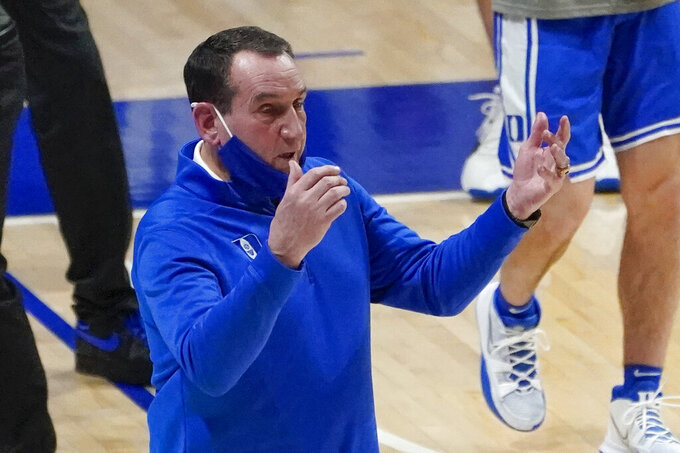 Duke coach Mike Krzyzewski calls to players during the first half of the team's NCAA college basketball game against Pittsburgh, Tuesday, Jan. 19, 2021, in Pittsburgh. (AP Photo/Keith Srakocic)