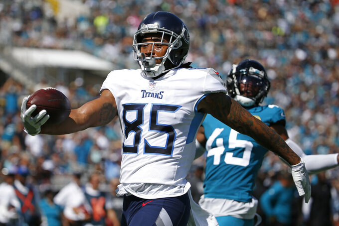 Tennessee Titans tight end MyCole Pruitt (85) celebrates his touchdown against the Jacksonville Jaguars during the first half of an NFL football game, Sunday, Oct. 10, 2021, in Jacksonville, Fla. (AP Photo/Stephen B. Morton)