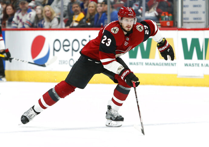 FILE - This Jan. 6, 2019, file photo shows Arizona Coyotes defenseman Oliver Ekman-Larsson skating against the New York Rangers during the first period of an NHL hockey game in Glendale, Ariz. Coyotes captain Oliver Ekman-Larsson labored through the first part of the 2019-20 season as a knee injury lingered. The time off during the NHL's shutdown and a trip home to Sweden allowed the defenseman a chance to heal, giving the Coyotes a boost as the postseason nears. (AP Photo/Ralph Freso, File)
