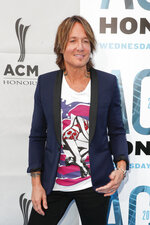 FILE - Keith Urban arrives at the 13th Annual ACM Honors in Nashville, Tenn. on  Aug. 21, 2019. Urban's latest album