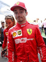 Ferrari driver Charles Leclerc of Monaco walks in the pit lane after qualification ahead of the Belgian Formula One at Spa-Francorchamps, Belgium, Saturday, Aug. 31, 2019. The Belgian Formula One race will take place on Sunday and Leclerc will start in pole position. (AP Photo/Francisco Seco)