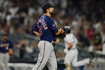 Minnesota Twins pitcher Kyle Barraclough reacts as New York Yankees' Luke Voit runs the bases after hitting a home run during the seventh inning of a baseball game Friday, Aug. 20, 2021, in New York. (AP Photo/Frank Franklin II)