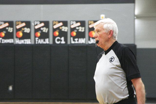 John Klinnert, 72, of Fergus Falls officiates a boys' basketball game between Pelican Rapids Vikings and Barnesville Trojans in Pelican Rapids, Minn., on Friday, Jan. 31, 2020. Klinnert officiated his first basketball game in 1977. (Matt Mikus/Minnesota Public Radio via AP)