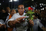 Thai Prime Minister Prayuth Chan-ocha of the Palang Pracharat Party arrives, during an election campaign in Bangkok, Thailand, Friday, March 22, 2019. The political movement that has won every Thai election in nearly two decades is facing its biggest test yet: Squaring off against the allies of the military junta that removed it from power and rewrote the electoral rules with the goal of putting an end to those victories. (AP Photo/Sakchai Lalit)