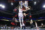 Philadelphia 76ers' Ben Simmons (25) leaps for a rebound against Chicago Bulls' Kris Dunn (32), Lauri Markkanen (24) and Luke Kornet (2) during the first half of an NBA basketball game, Friday, Jan. 17, 2020, in Philadelphia. (AP Photo/Matt Slocum)