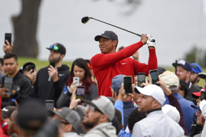 Tiger Woods watches his tee shot on the second hole of the South Course at Torrey Pines Golf Course during the final round of the Farmers Insurance golf tournament Sunday, Jan. 26, 2020, in San Diego. (AP Photo/Denis Poroy)