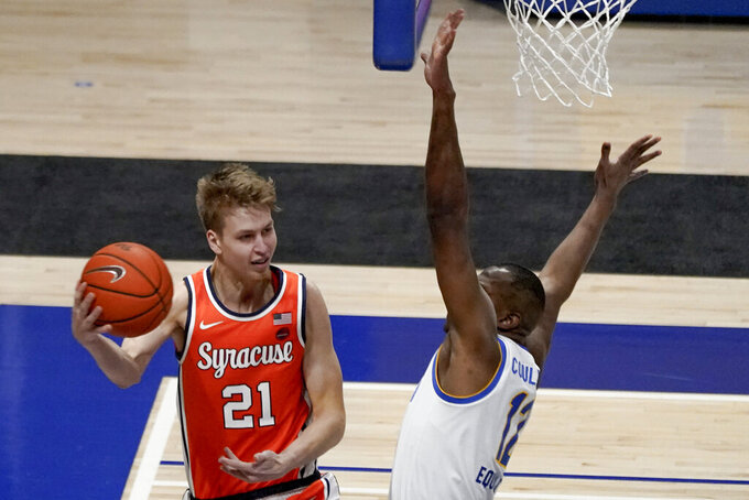 Syracuse's Marek Dolezaj, left, looks to pass as Pittsburgh's Abdoul Karim Coulibaly (12) defends during the second half of an NCAA college basketball game, Saturday, Jan. 16, 2021, in Pittsburgh. Pittsburgh won 96-76. (AP Photo/Keith Srakocic)