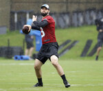 Carolina Panthers rookie quarterback Will Grier (3) looks to pass during the NFL football team's rookie camp in Charlotte, N.C., Friday, May 10, 2019. (AP Photo/Chuck Burton)
